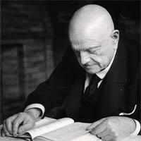 An older Jean Sibelius enjoying a book